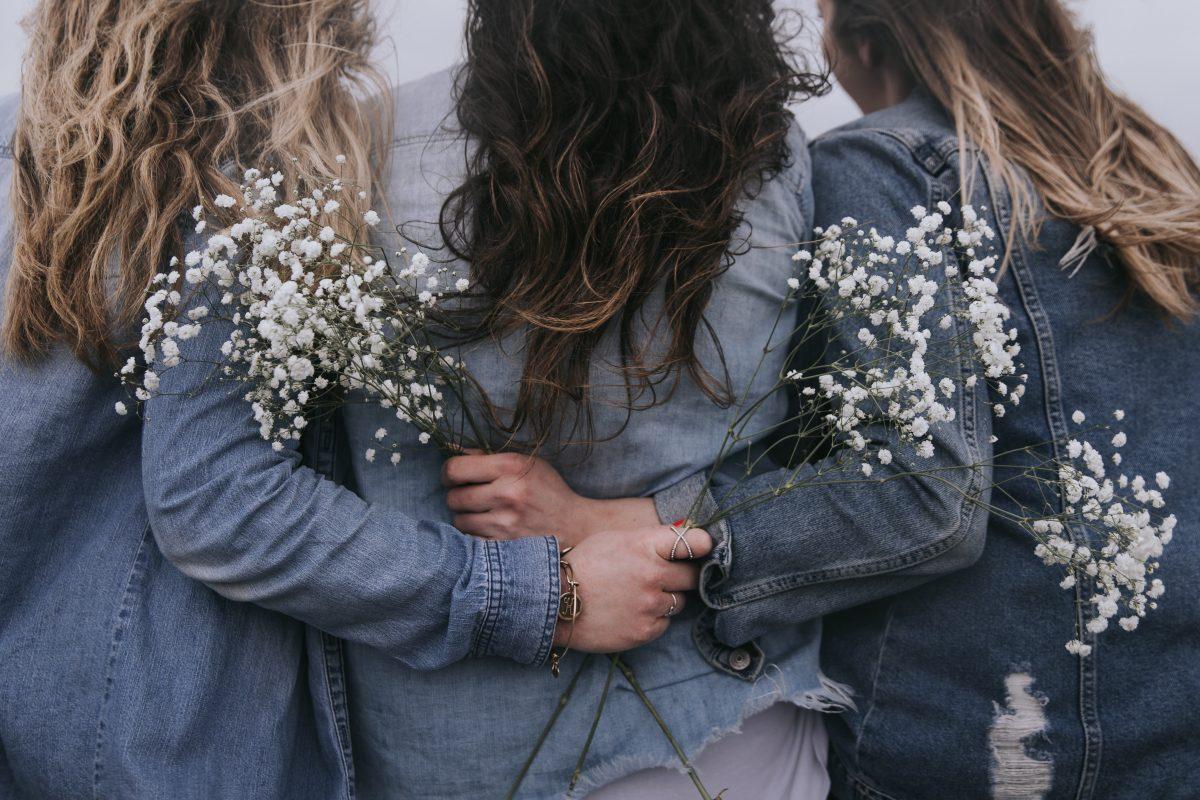 3 women giving each other a hug