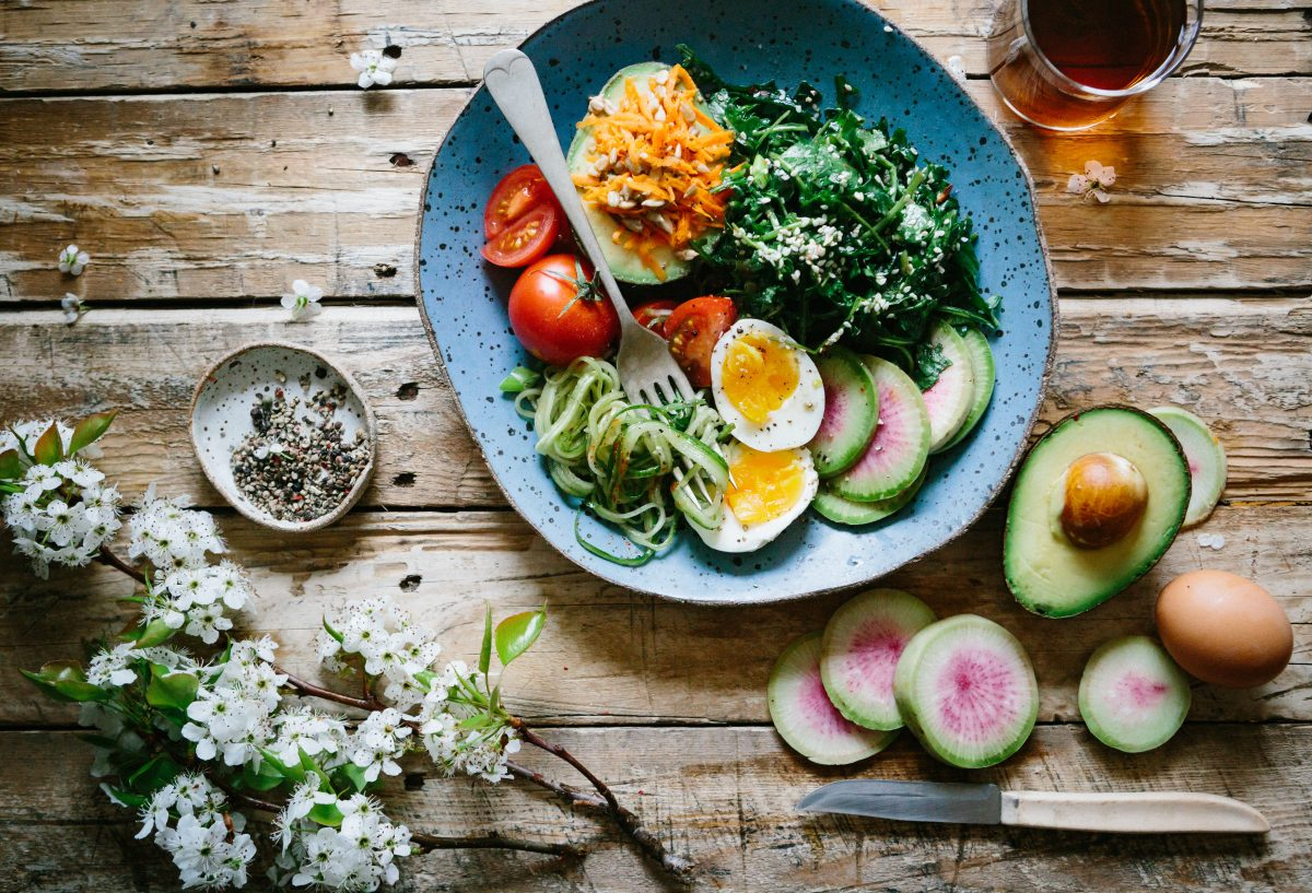 healthy salad in a bowl on a wood table