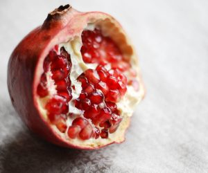 pomegranate against a white background