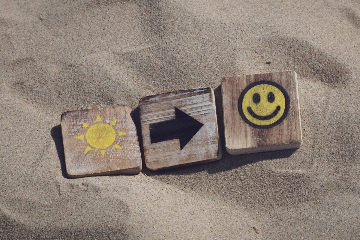 blocks in the sand that are sunshine arrow smiley face