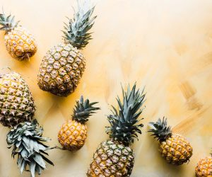 pineapples arranged against a gold surface