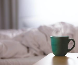 mug of tea next to an empty bed