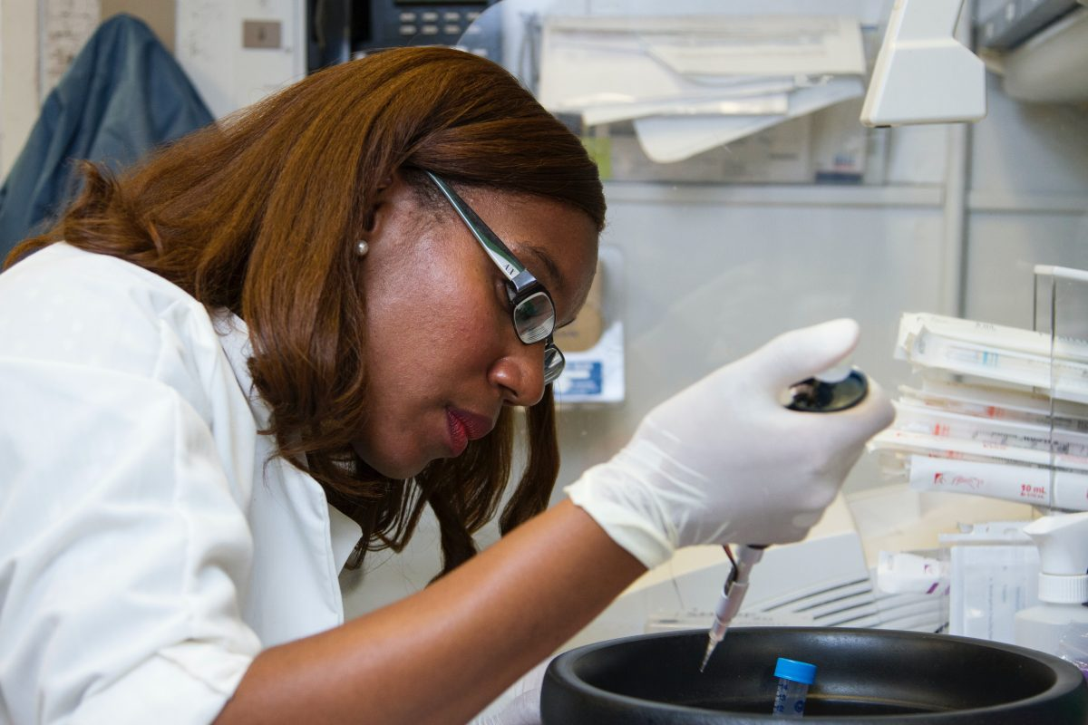 woman working in a cancer research lab