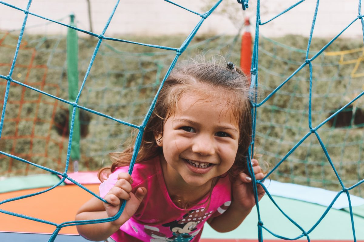 Little girl smiling and playing at the park
