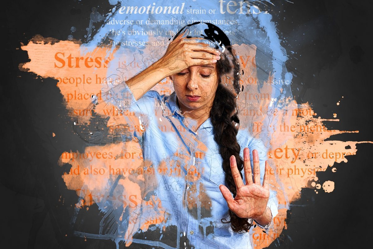 woman holding her head looking stressed