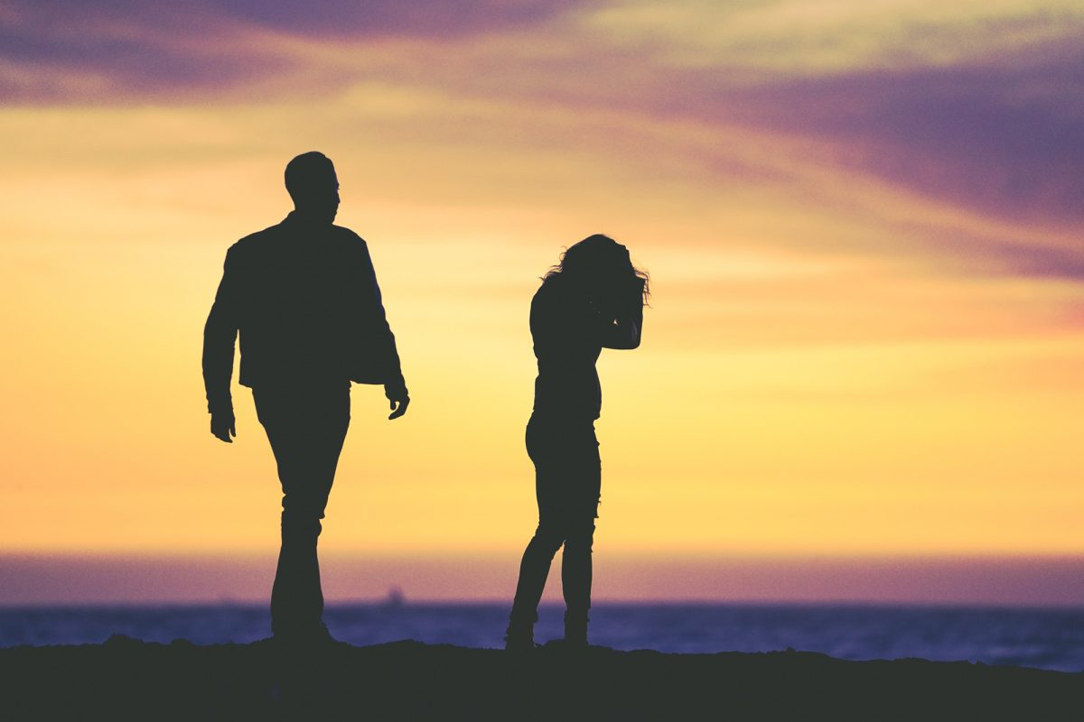 silhouettes of a man and woman in argument