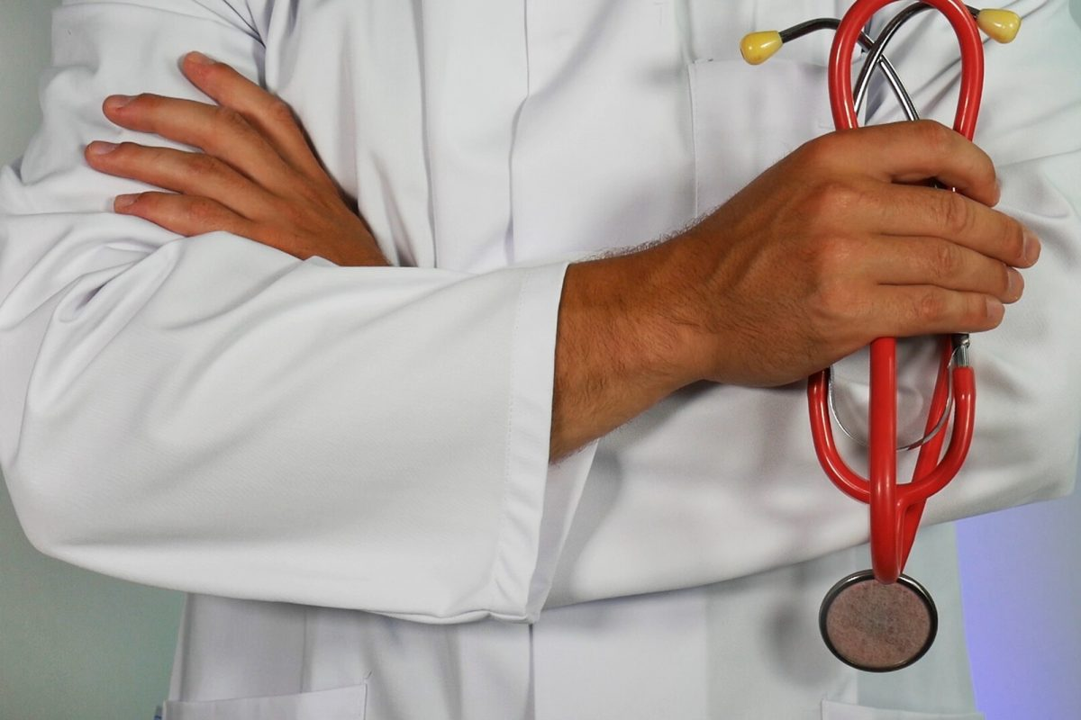 Doctor with arms crossed holding a stethoscope