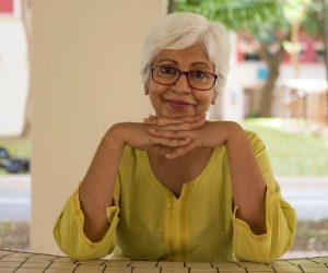 older woman smiling at the camera