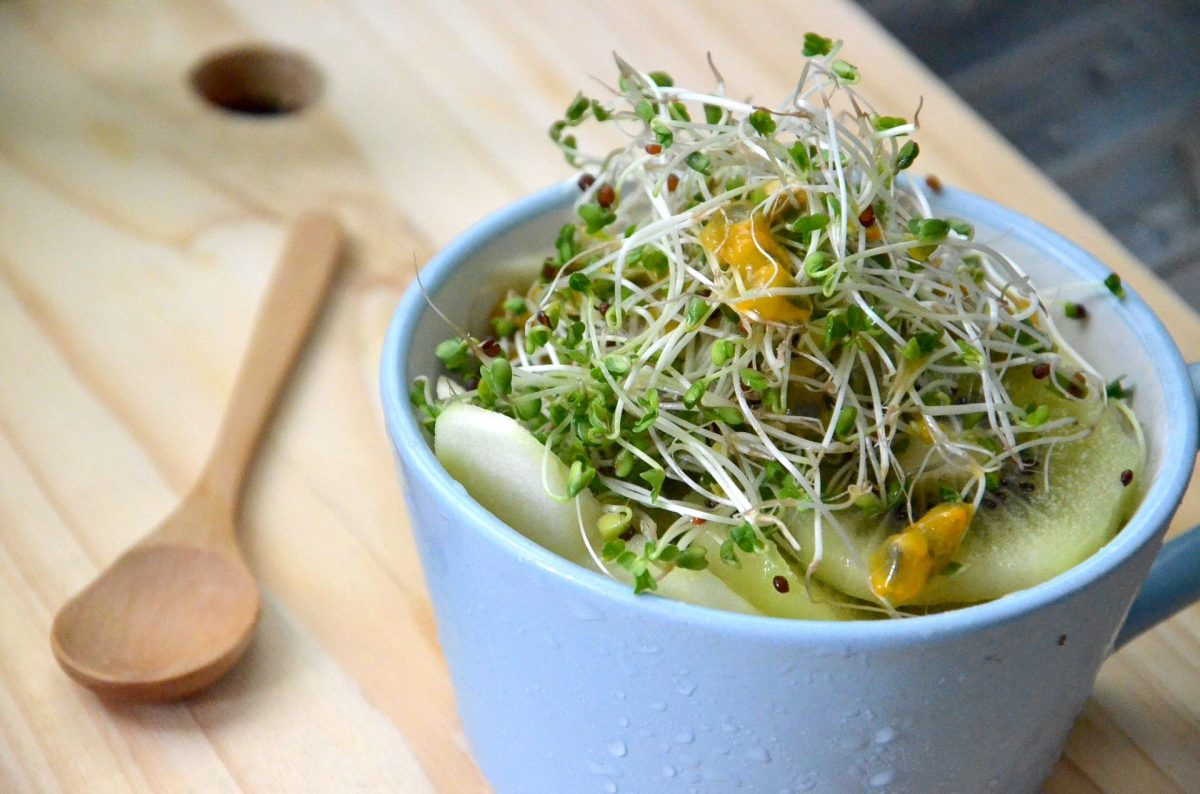 bowl of salad with broccoli sprouts on the top